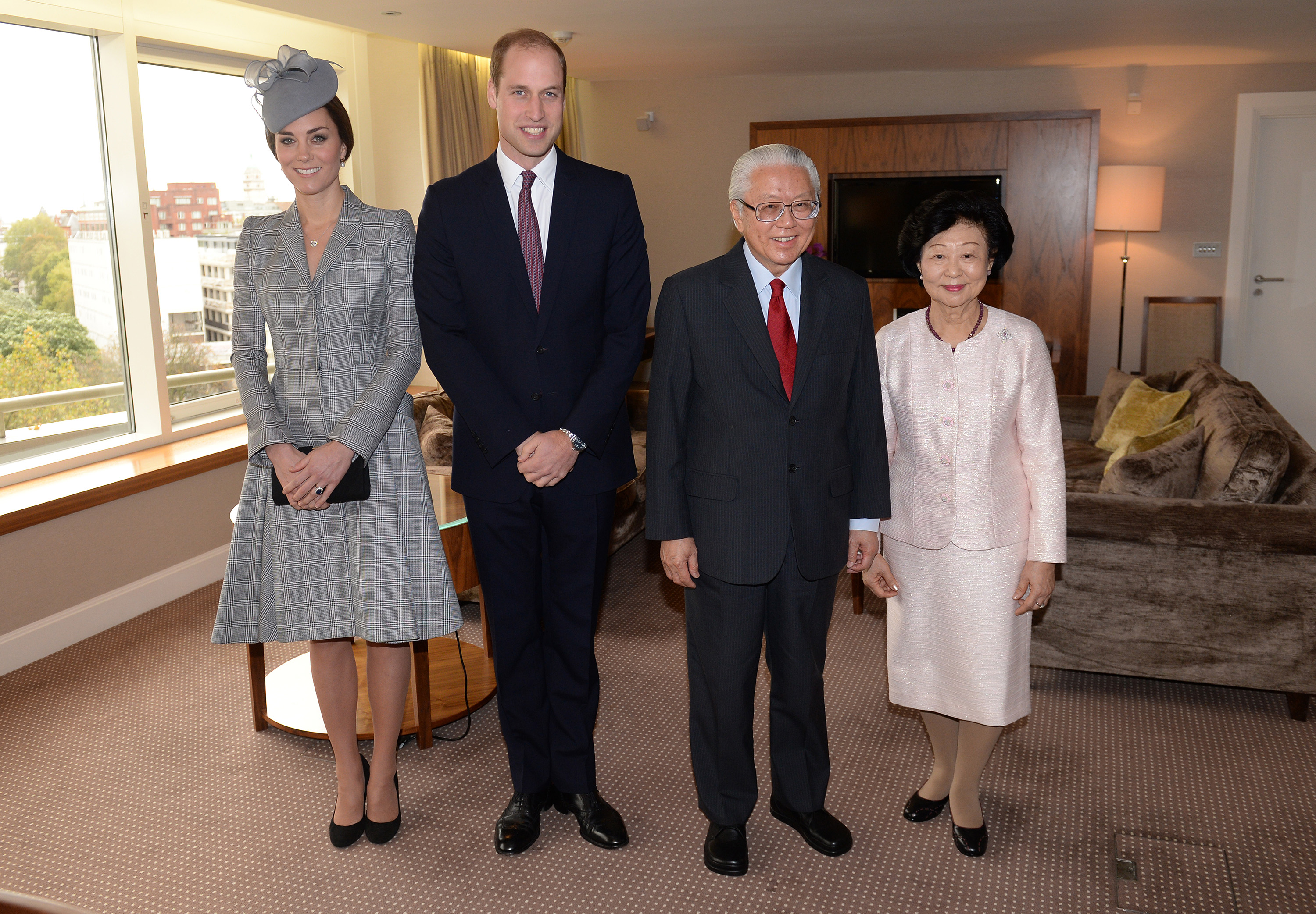 The Duke and Duchess of Cambridge greet the president of Singapore