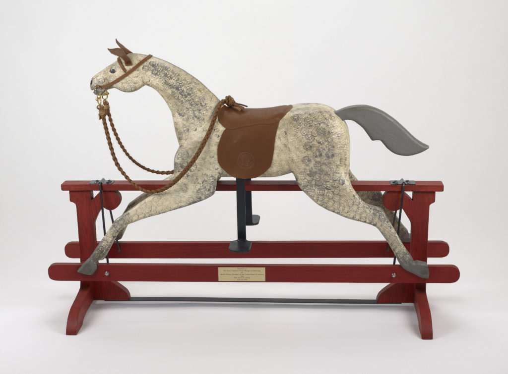 Rocking horse presented by President Obama and Mrs Obama to Prince George, 2013 Credit line: Royal Collection Trust / (C) Her Majesty Queen Elizabeth II 2014. The Summer Opening of the State Rooms at Buckingham Palace and the special exhibition 'Royal Childhood', 26 July - 28 September 2014. This image is supplied for single use only and should not be archived or passed on to third parties.