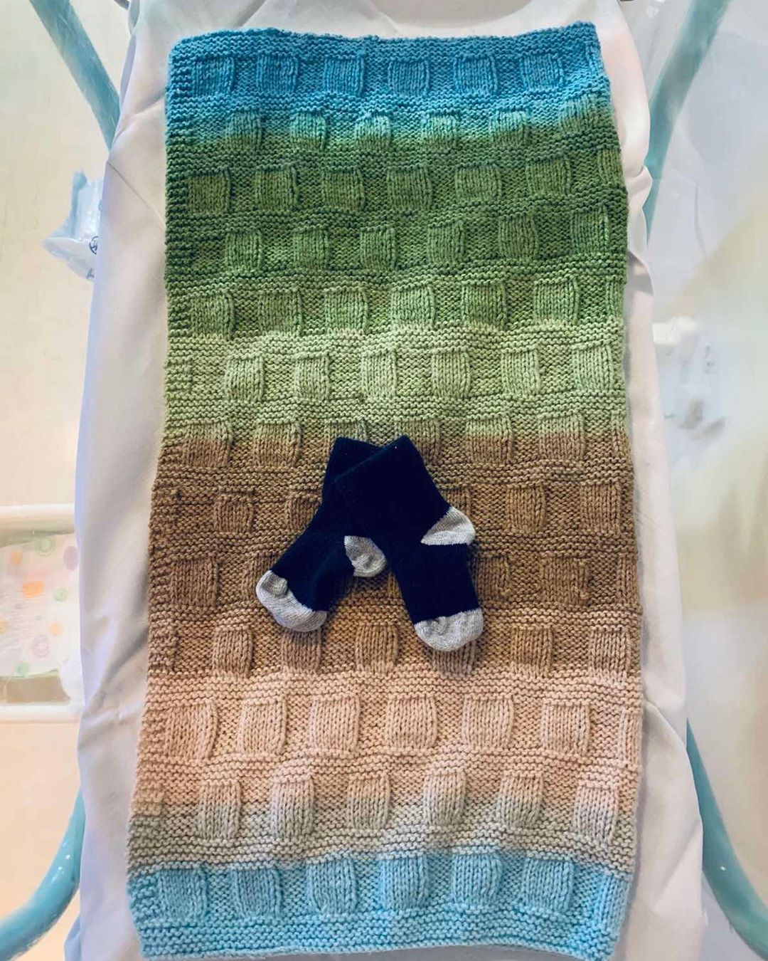 picture of baby blanket and baby socks
